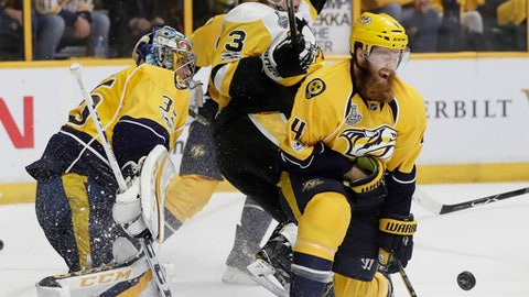 FILE - In this June 11, 2017, file photo, Nashville Predators' Ryan Ellis (4) and goalie Pekka Rinne (35), of Finland, defend the goal against Pittsburgh Penguins' Olli Maatta (3), of Finland, during the second period of Game 6 of the NHL hockey Stanley Cup Final, in Nashville, Tenn. Ryan Ellis will need a full six months to recover from offseason knee surgery, and general manager David Poile says they don't expect him back until possibly 2018. Poile gave an update on a couple injuries Thursday, Sept. 7, 2017, after a rookies' practice.  (AP Photo/Mark Humphrey, File)