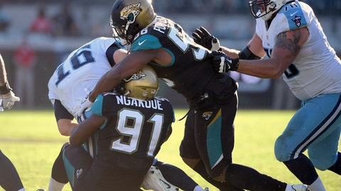 FILE - In this Dec. 24, 2016, file photo, Jacksonville Jaguars defensive end Dante Fowler (56) and defensive end Yannick Ngakoue (91) sack Tennessee Titans quarterback Matt Cassel (16) during the second half of an NFL football game in Jacksonville, Fla. The Jaguars have not had anyone record double-digit sacks since 2006. It is a decade-old streak the Jaguars hope to end this season with edge-rushers Ngakoue and Fowler. (AP Photo/Phelan M. Ebenhack, File)