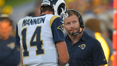 FILE - In this Aug. 26, 2017, file photo, Los Angeles Rams head coach Sean McVay, right, talks with quarterback Sean Mannion (14) during the first half of a preseason NFL football game against the Los Angeles Chargers in Los Angeles. McVay will become the youngest head coach in modern NFL history when the Rams host Indianapolis on Sunday, Sept. 10, 2017. (AP Photo/Mark J. Terrill, File)