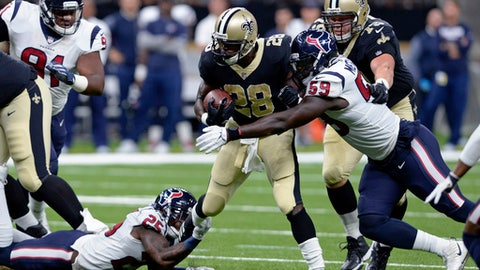"""FILE - In this Aug. 26, 2017, file photo, New Orleans Saints running back Adrian Peterson (28) carries between Houston Texans cornerback Kareem Jackson (25) and outside linebacker Whitney Mercilus (59) during a preseason NFL football game in New Orleans. When Peterson wore purple, the revered running back was naturally off limits for Minnesota's defense during practice. """"But now it's a must,"""" Vikings cornerback Xavier Rhodes said. """"You have to tackle him. It's going to be pretty fun.""""  (AP Photo/Bill Feig, File)"""
