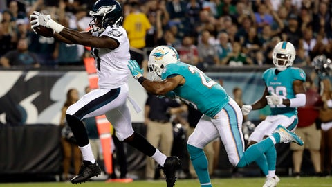 FILE - In this Aug. 24, 2017, file photo, Philadelphia Eagles' Alshon Jeffery, left, scores a touchdown past Miami Dolphins' Nate Allen during the first half of a preseason NFL football game in Philadelphia. Jeffery is looking forward to going against Washington Redskins cornerback Josh Norman, who likes to talk trash. He has 11 catches for 189 yards and a touchdown in two games against Norman. (AP Photo/Matt Rourke, File)