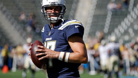 FILE - In this Aug. 20, 2017, file photo, Los Angeles Chargers quarterback Philip Rivers warms up before an NFL preseason football game against the New Orleans Saints in Carson, Calif. Rivers is commuting from his family's home in San Diego to the Chargers' new training complex in a $200,000 RV this season. Even though he didn't move his wife and eight children north when the Chargers relocated, the veteran quarterback is eager to lead the Chargers' rebound when he begins his 12th season as their starter. (AP Photo/Jae C. Hong, File)