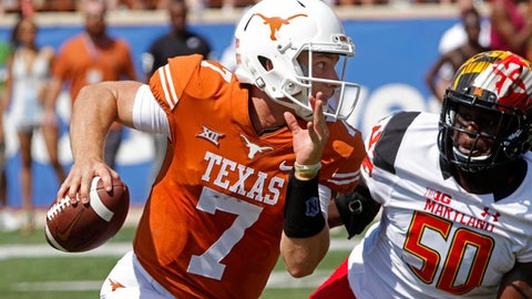 FILE - In this Sept. 2, 2017, file photo, Texas quarterback Shane Buechele (7) runs the ball against Maryland linebacker Mbi Tanyi (50) during the first half of an NCAA college football game in Austin, Texas. Buechele has not thrown in practice this week because of a bruised shoulder and coach Tom Herman said his status for the game against San Jose State will be a game-day decision. (AP Photo/Michael Thomas, File)