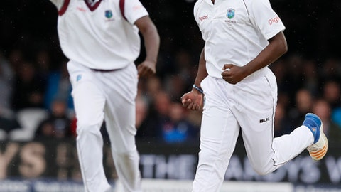 West Indies' Kemar Roach celebrates taking the wicket of England's Dawid Malan on the second day of the third test match between England and the West Indies at Lord's cricket ground in London, Friday, Sept. 8, 2017. (AP Photo/Kirsty Wigglesworth)