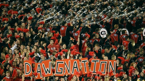 FILE - In this Oct. 17, 2015, file photo, the Georgia band performs in the second half of an NCAA college football game against Missouri, in Athens, Ga. The first-regular season meeting between Georgia and Notre Dame on Saturday is the most-anticipated road trip the Bulldogs have made in decades. The red and black of Georgia started pouring into South Bend on Thursday, Sept. 7, 2017, and Bulldogs fans were making their presence felt. (AP Photo/John Bazemore, File)
