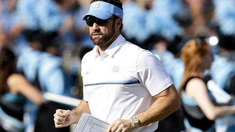 FILE - In this Nov. 25, 2016, file photo, North Carolina head coach Larry Fedora runs onto the field prior to an NCAA college football game against North Carolina State in Chapel Hill, N.C. Fedora's Tar Heels open Atlantic Coast Conference play Saturday, Sept. 9, 2017, at home against No. 17 Louisville. (AP Photo/Gerry Broome, File)