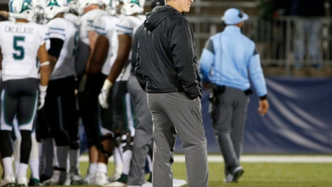 FILE - In this Nov. 26, 2016, file photo, Tulane coach Willie Fritz stands on the field during a break in the second half of the team's NCAA college football game against Connecticut in East Hartford, Conn. Fritz and Navy coach Ken Niumatalolo are two of the nation's foremost practitioners of the option offense. Niumatalolo played quarterback in the triple-option at Hawaii then served as an assistant under option architect Paul Johnson for 13 years. Fritz pioneered the zone option and has employed that type of attack throughout his successful 24-year career as a head coach. Navy and Tulane meet this Saturday. (AP Photo/Mary Schwalm, File)