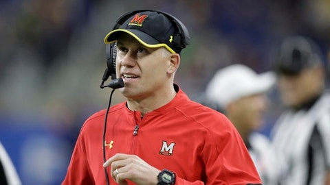 FILE - In this Dec. 26, 2016, file photo, Maryland coach DJ Durkin walks the sideline during the first half of the Quick Lane Bowl NCAA college football game against Boston College in Detroit. Maryland plays Towson this week. (AP Photo/Carlos Osorio, File)