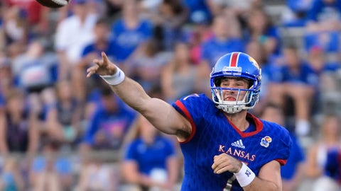 FILE - In this Sept. 2, 2017, file photo, Kansas quarterback Peyton Bender (7) during the first half of an NCAA college football game against Southeast Missouri State in Lawrence, Kan. Bender hopes to replicate is performance last week against Southeast Missouri State this Saturday against Central Michigan. Bender threw for 363 yards and four touchdowns in the Jayhawks' season opener.(AP Photo/Reed Hoffmann, File)