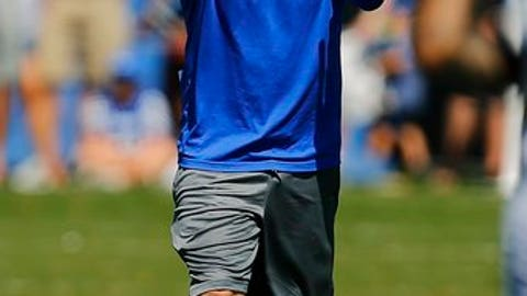 In this Aug. 5, 2015, photo, University of Kentucky special teams coach Dean Hood gestures during an NCAA college football practice in Lexington, Ky. Kentucky had to rally late before beating Eastern Kentucky in overtime when the schools last met in 2015. The Wildcats aim to avoid another close call this time with former EKU coach Dean Hood on their sideline.(Alex Slitz/Lexington Herald-Leader via AP)