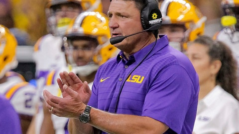 FILE - In this Saturday, Sept. 2, 2017, file photo, LSU head coach Ed Orgeron claps during an NCAA college football game against BYU in New Orleans. Orgeron didn't have to wait long to see what a number of his new recruits could do. He may very well see a lot more of his youngest players on Saturday, Sept. 9 when the 12th-ranked Tigers (1-0) open their home slate against Chattanooga (0-1) of the NCAA's second-tier Football Championship Subdivision.  (AP Photo/Scott Threlkeld, File)