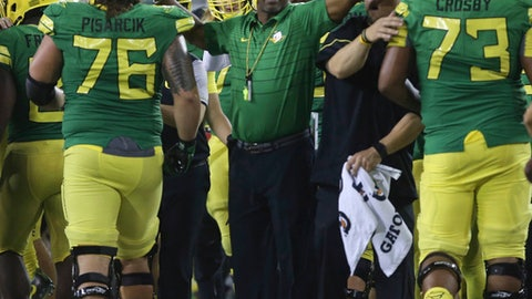 FILE - In this Sept. 2, 2017, file photo, Oregon coach Willie Taggart, center, congratulates his offense after a third-quarter touchdown against Southern Utah during an NCAA college football game Saturday in Eugene, Ore. Oregon will host Nebraska for a high-profile early season game in Eugene, on Saturday, Sept. 9.(AP Photo/Chris Pietsch, file)
