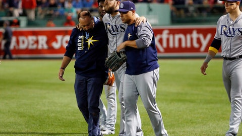 Tampa Bay Rays right fielder Steven Souza Jr. is helped off the field after being injured chasing a fly ball during the fourth inning of a baseball game against the Boston Red Sox at Fenway Park in Boston, Friday, Sept. 8, 2017. (AP Photo/Winslow Townson)