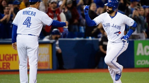 Toronto Blue Jays' Jose Bautista, right, celebrates his solo home run against the Detroit Tigers with third base coach Luis Rivera during the eighth inning of a baseball game in Toronto on Friday, Sept. 8, 2017. (Nathan Denette/The Canadian Press via AP)