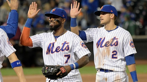New York Mets shortstop Jose Reyes (7) and second baseman Gavin Cecchini celebrate after they defeated the Cincinnati Reds in a baseball game Friday, Sept. 8, 2017, in New York. (AP Photo/Bill Kostroun)