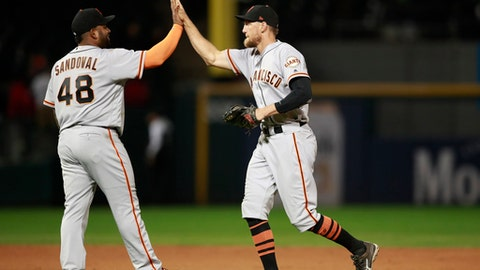 San Francisco Giants third baseman Pablo Sandoval (48) and right fielder Hunter Pence celebrate after defeaing the Chicago White Sox during baseball game in Chicago, Friday, Sept. 8, 2017. (AP Photo/Jeff Haynes)