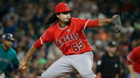 Los Angeles Angels relief pitcher Noe Ramirez throws to a Seattle Mariners batter during the fifth inning of a baseball game, Friday, Sept. 8, 2017, in Seattle. (AP Photo/Ted S. Warren)