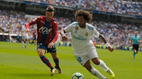"""Real Madrid's Marcelo, right, battles for the ball with Levante's David Remeseiro """"Jason"""" during the Spanish La Liga soccer match between Real Madrid and Levante at the Santiago Bernabeu stadium in Madrid, Saturday, Sept. 9, 2017. (AP Photo/Francisco Seco)"""