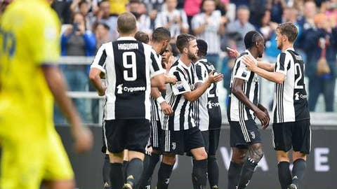 Juventus players celebrates after scoring a goal during the Italian Serie A Soccer match between Juventus and Chievo at the Allianz Stadium in Turin, Italy, Saturday, Sept. 9, 2017. (Alessandro Di Marco/ANSA via AP)