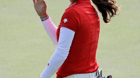 Minjee Lee, of Australia, smiles after making a birdie on the third hole during the final round of the Indy Women in Tech Championship golf tournament, Saturday, Sept. 9, 2017, in Indianapolis. (AP Photo/Darron Cummings)