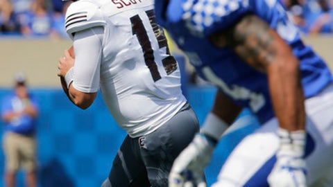 Eastern Kentucky quarterback Austin Scott looks for a receiver during the first half of an NCAA college football game against Kentucky, Saturday, Sept. 9, 2017, in Lexington, Ky. (AP Photo/David Stephenson)