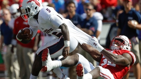 Wisconsin's Leon Jacobs (32) stops Florida Atlantic's Devin Singletary (5)on a third down run during the first half of an NCAA college football game Saturday, Sept. 9, 2017, in Madison, Wis. (AP Photo/Morry Gash)