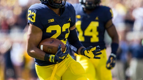 Michigan defensive back Tyree Kinnel (23) rushes back an interception for a touchdown in the first quarter of an NCAA college football game against Cincinnati in Ann Arbor, Mich., Saturday, Sept. 9, 2017. (AP Photo/Tony Ding)