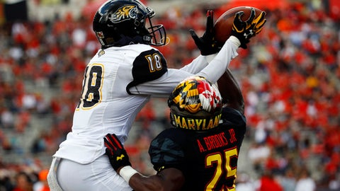 Towson wide receiver Jabari Allen, left, makes a touchdown catch over Maryland defensive back Antoine Brooks in the first half of an NCAA college football game in College Park, Md., Saturday, Sept. 9, 2017. (AP Photo/Patrick Semansky)