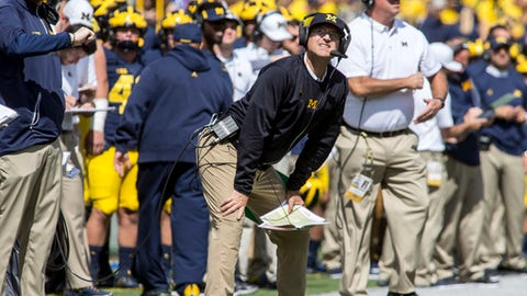 Michigan head coach Jim Harbaugh looks up at the scoreboard from the sideline in the second quarter of an NCAA college football game against Cincinnati in Ann Arbor Mich. Saturday Sept. 9 2017