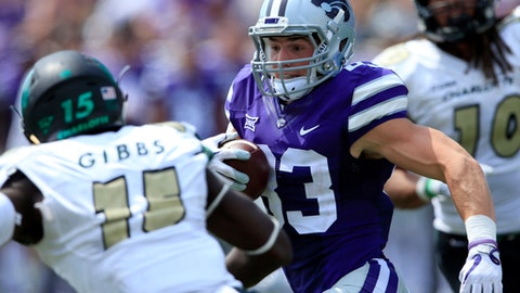 Kansas State wide receiver Dalton Schoen (83) gets around Charlotte defensive back Marquavis Gibbs (15) during the second half of an NCAA college football game in Manhattan, Kan., Saturday, Sept. 9, 2017. (AP Photo/Orlin Wagner)