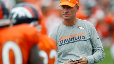 FILE - In this Saturday, July 29, 2017 file photo, Denver Broncos offensive coordinator Mike McCoy looks on during drills at an NFL football training camp in Englewood, Colo. Mike McCoy is calling the plays again instead of the shots. His second stint as Denver's play-caller begins Monday night, Sept. 11, 2017 against the Chargers, the team that fired him as their head coach nine months ago.(AP Photo/David Zalubowski, File)