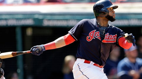 Cleveland Indians' Carlos Santana watches his ball after hitting a one-run double off Baltimore Orioles starting pitcher Gabriel Ynoa in the fifth inning of a baseball game, Saturday, Sept. 9, 2017, in Cleveland. Lonnie Chisenhall scored on the play. (AP Photo/Tony Dejak)