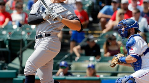 New York Yankees' Aaron Judge spins around as he strikes out in front of Texas Rangers catcher Brett Nicholas, right, in the fourth inning of a baseball game, Saturday, Sept. 9, 2017, in Arlington, Texas. (AP Photo/Tony Gutierrez)