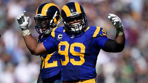 FILE - In this Sept. 18, 2016, file photo, Los Angeles Rams defensive tackle Aaron Donald tries to fire up the crowd during the team's NFL football game against the Seattle Seahawks at Los Angeles Memorial Coliseum in Los Angeles. All-Pro defensive lineman Aaron Donald has reported to the Los Angeles Rams, ending a holdout that began in May. The Rams confirmed Saturday, Sept. 9, 2017 they did not agree on a new contract with Donald. (AP Photo/Kelvin Kuo, File)