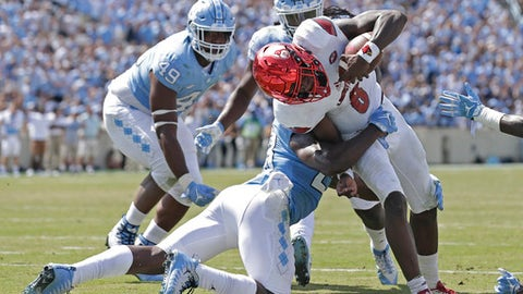 Louisville quarterback Lamar Jackson (8) scores as North Carolina's Cayson Collins (23) tries to make the tackle during the second half of an NCAA college football game in Chapel Hill, N.C., Saturday, Sept. 9, 2017. Louisville won 47-35. (AP Photo/Gerry Broome)