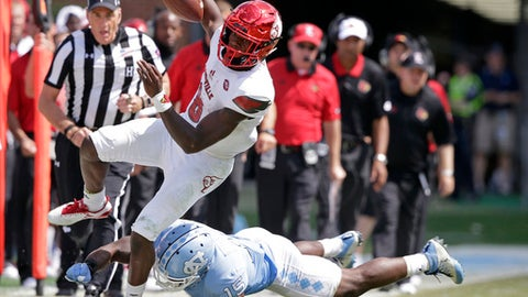 Louisville quarterback Lamar Jackson (8) is pushed out of bounds by North Carolina's Donnie Miles (15) during the second half of an NCAA college football game in Chapel Hill, N.C., Saturday, Sept. 9, 2017. Louisville won 47-35. (AP Photo/Gerry Broome)