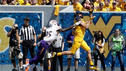 West Virginia wide receiver David Sills V (13) makes a touchdown catch while being defended by East Carolina defensive back Chris Love (35) during the first half of an NCAA college football game, Saturday, Sept. 9, 2017, in Morgantown, W.Va. West Virginia defeated East Carolina 56-20. (AP Photo/Raymond Thompson)