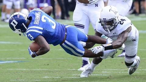 Northwestern's Montre Hartage (24) tackles Duke's T.J. Rahming during an NCAA college football game, Saturday, Sept. 9, 2017, in Durham, N.C. (Bernard Thomas/The Herald-Sun via AP)