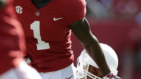 Fresno State defensive end Kwami Jones tackles Alabama wide receiver Robert Foster in the first half of an NCAA college football game, Saturday, Sept. 9, 2017, in Tuscaloosa, Ala. (AP Photo/Brynn Anderson)