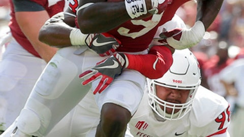 Alabama running back Bo Scarbrough runs the ball against Fresno State defensive tackle Keiti Iakopo in the first half of an NCAA college football game, Saturday, Sept. 9, 2017, in Tuscaloosa, Ala. (AP Photo/Brynn Anderson)