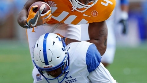 Tennessee tight end Jakob Johnson (44) is upended by Indiana State safety Lonnie Walker II (2) in the first half of an NCAA college football game Saturday, Sept. 9, 2017, in Knoxville, Tenn. (AP Photo/Wade Payne)