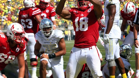 Nebraska running back Tre Bryant, center, celebrates after scoring a touchdown during the second quarter against Oregon during an NCAA college football game Saturday, Sept. 9, 2017, in Eugene, Ore. (AP Photo/Chris Pietsch)