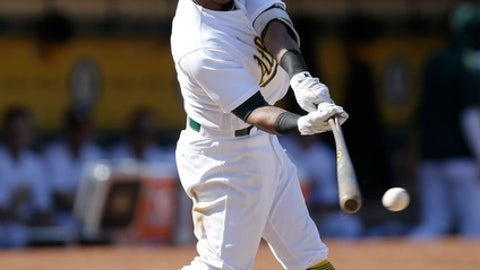 Oakland Athletics' Khris Davis connects for a two run single against the Houston Astros in the sixth inning of the first baseball game of a doubleheader on Saturday, Sept. 9, 2017, in Oakland, Calif. (AP Photo/Ben Margot)