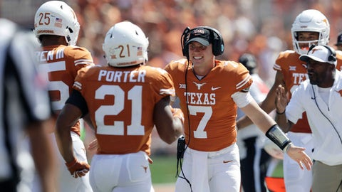 Texas quarterback Shane Buechele (7) celebrates with teammates after a score against San Jose State during the first half of an NCAA college football game, Saturday, Sept. 9, 2017, in Austin, Texas. Texas won 56-0. (AP Photo/Eric Gay)