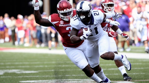 TCU running back Kyle Hicks (21) is tackled by Arkansas defender McTelvin Agim as he runs the ball in the first half of an NCAA college football game in Fayetteville, Ark., Saturday, Sept. 9, 2017. (AP Photo/Michael Woods)