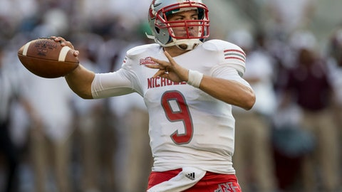 Nicholls State quarterback Chase Fourcade (9) passes downfield against Texas A&M during the first quarter of an NCAA college football game Saturday, Sept. 9, 2017, in College Station, Texas. (AP Photo/Sam Craft)