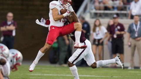 Nicholls State wide receiver Mason Roberts (13) catches a pass for a first down as Texas A&M defensive back Charles Oliver (21) defends during the first quarter of an NCAA college football game Saturday, Sept. 9, 2017, in College Station, Texas. (AP Photo/Sam Craft)