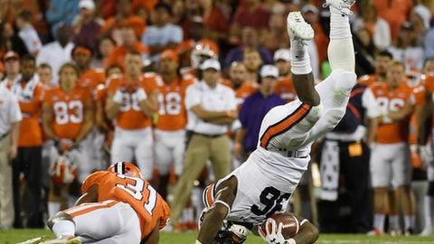 Auburn running back Kamryn Pettway (36) is tackled by Clemson cornerback Ryan Carter (31) during the second half of an NCAA college football game, Saturday, Sept. 9, 2017, in Clemson, S.C. (AP Photo/Rainier Ehrhardt)