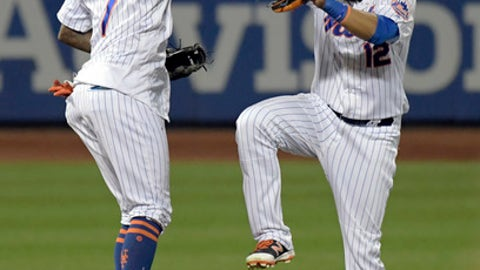 New York Mets shortstop Jose Reyes, left, celebrates with center fielder Juan Lagares after they defeated the Cincinnati Reds in a baseball game Saturday, Sept. 9, 2017, in New York. (AP Photo/Bill Kostroun)