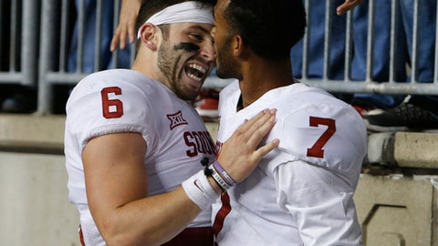 Oklahoma quarterback Baker Mayfield, left, celebrates their win over Ohio State with teammate Jordan Thomas in an NCAA college football game, Saturday, Sept. 9, 2017, in Columbus, Ohio. Oklahoma defeated Ohio State 31-16. (AP Photo/Jay LaPrete)